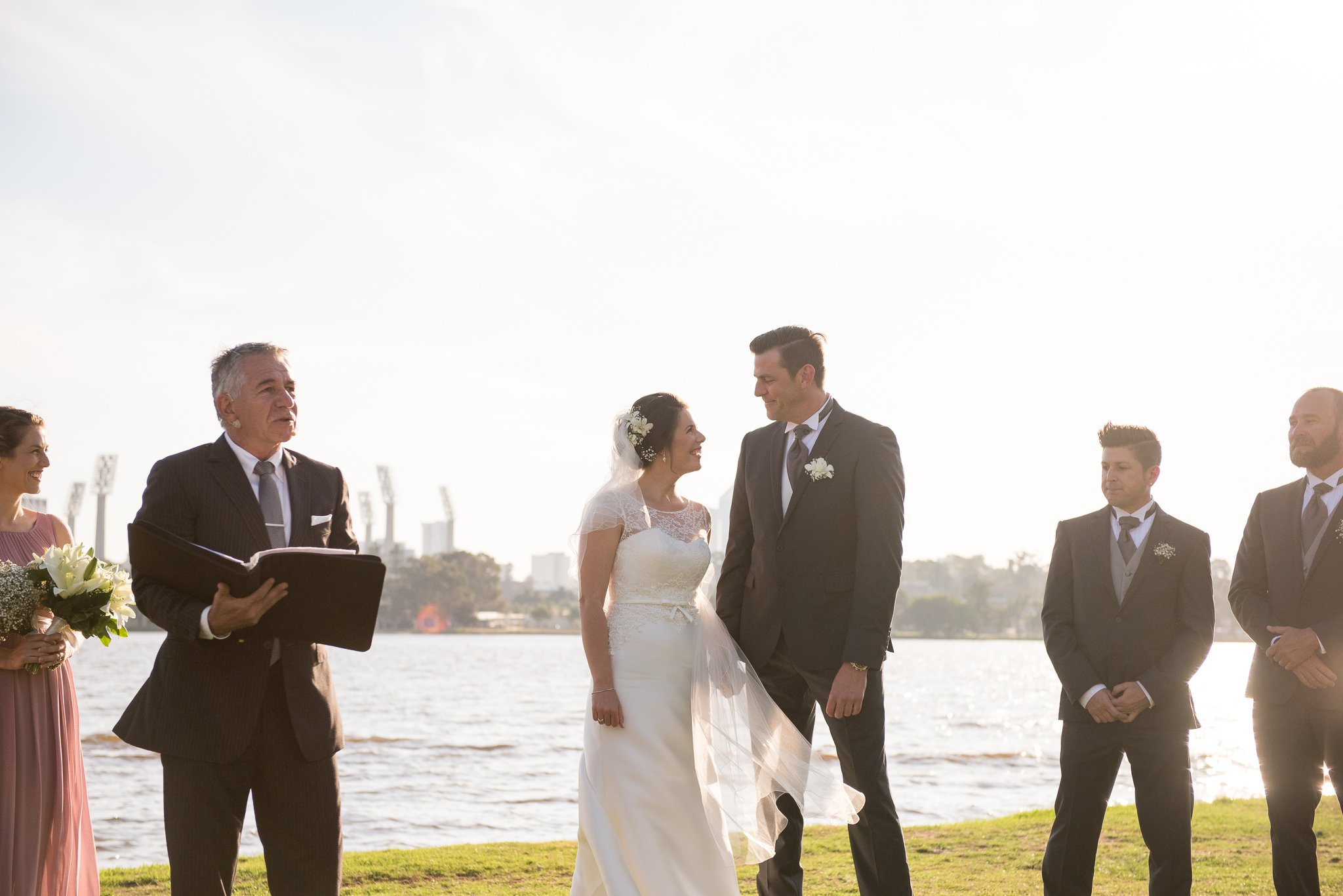 wedding ceremony with perth city behind