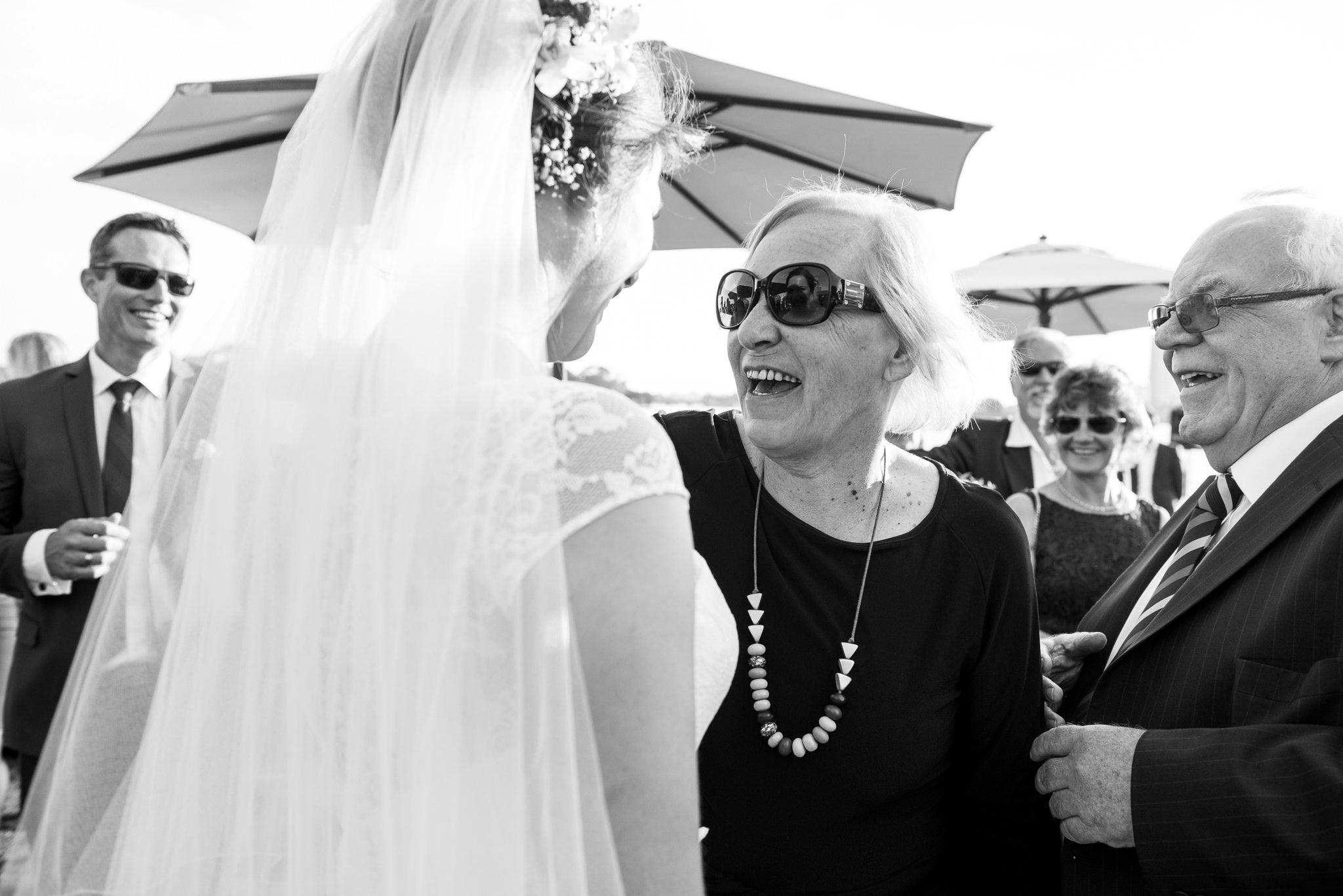 bride getting congratulated