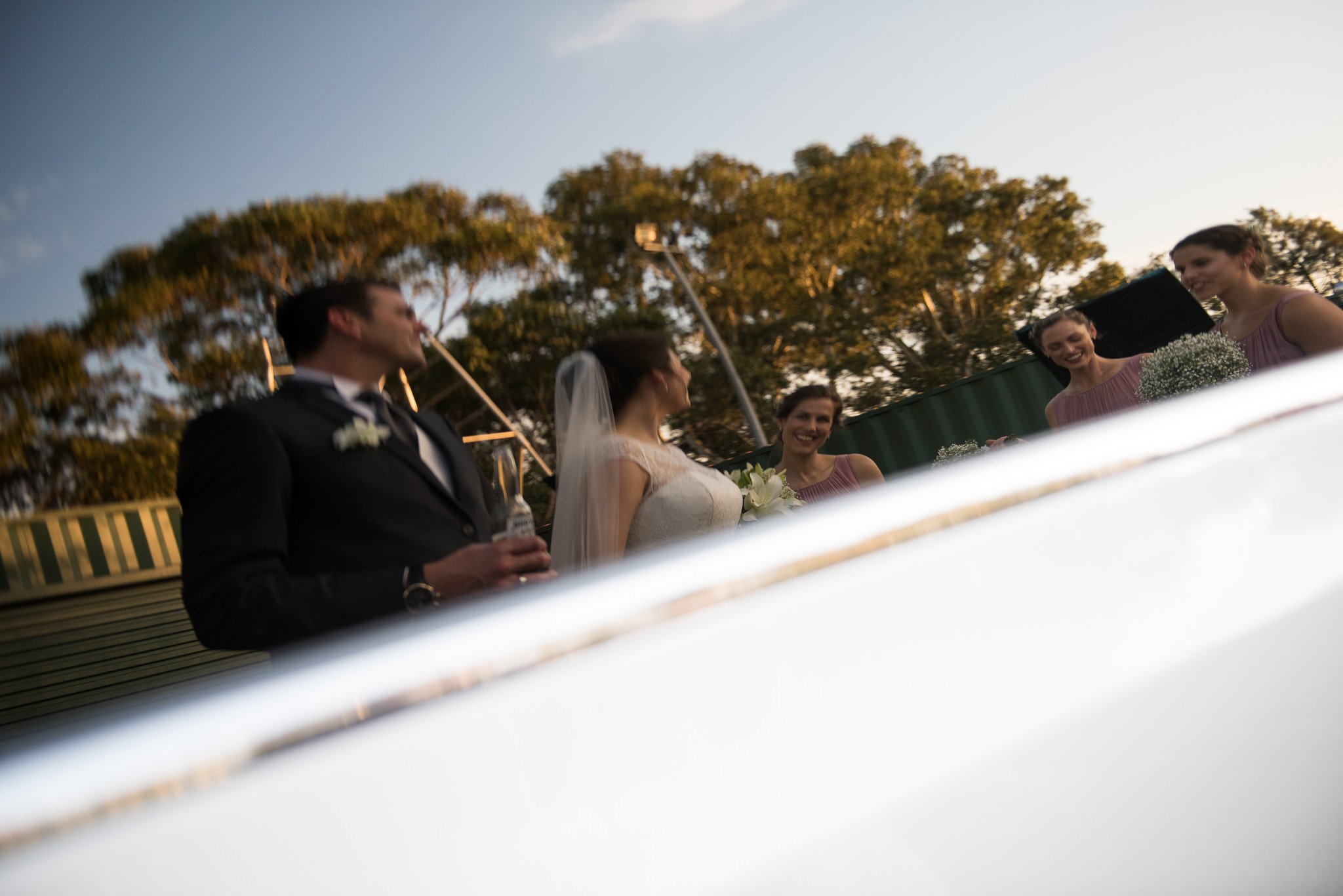 bride and groom reflection in limo