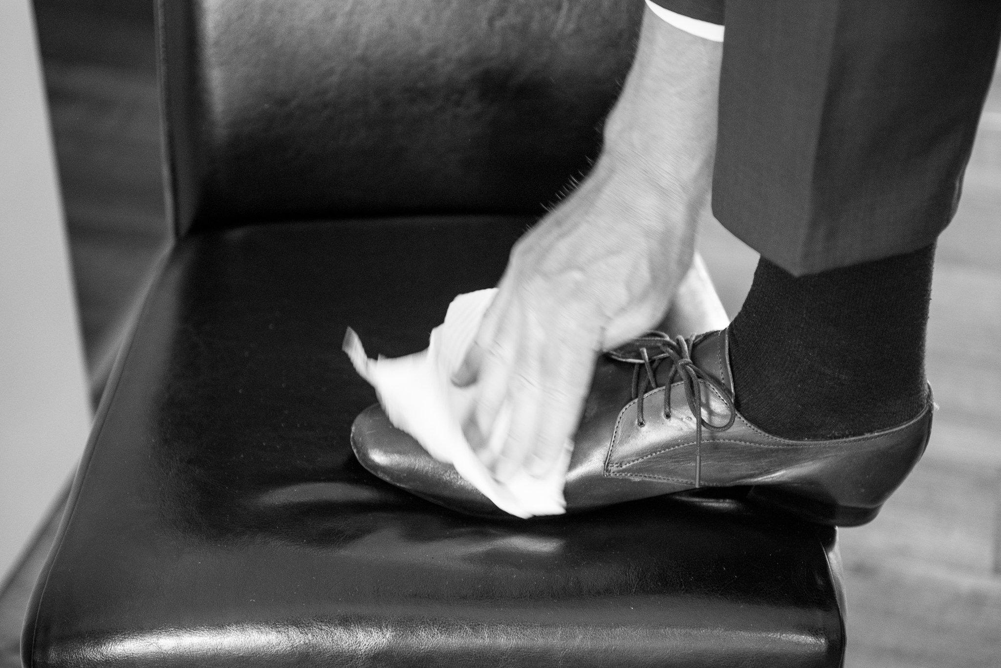 groom polishing shoes