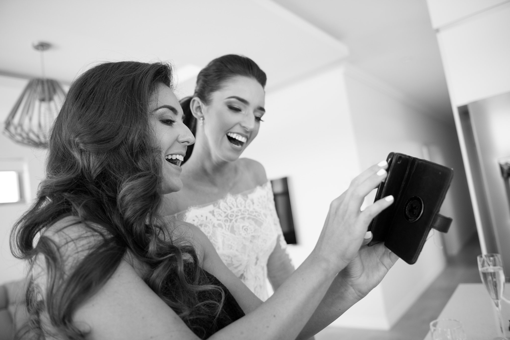 bride and friend laughing on skype