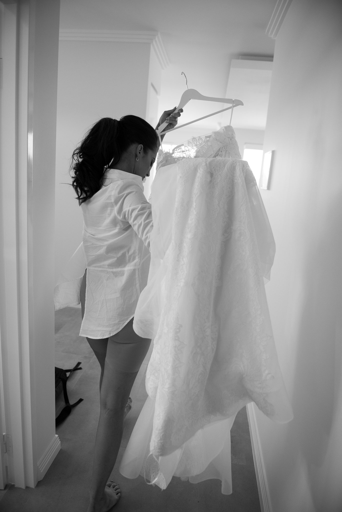 black-white bride carrying wedding dress