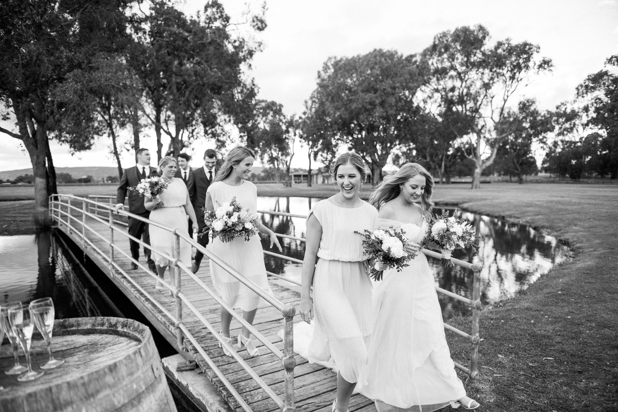 bridal party crossing a bridge