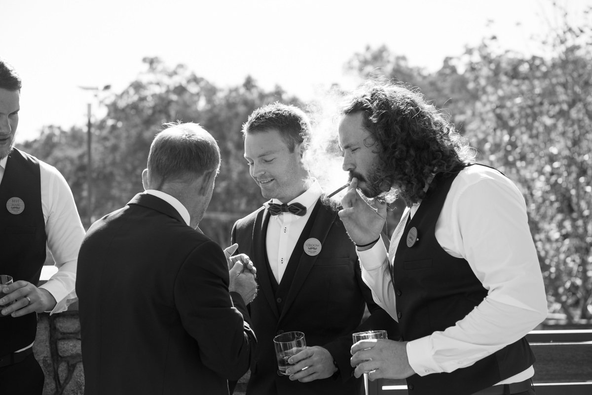 groomsmen smoking a cigar