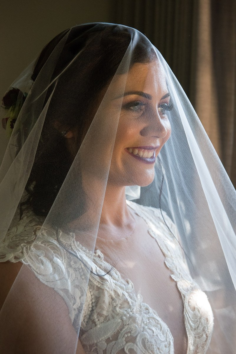 bride behing veil