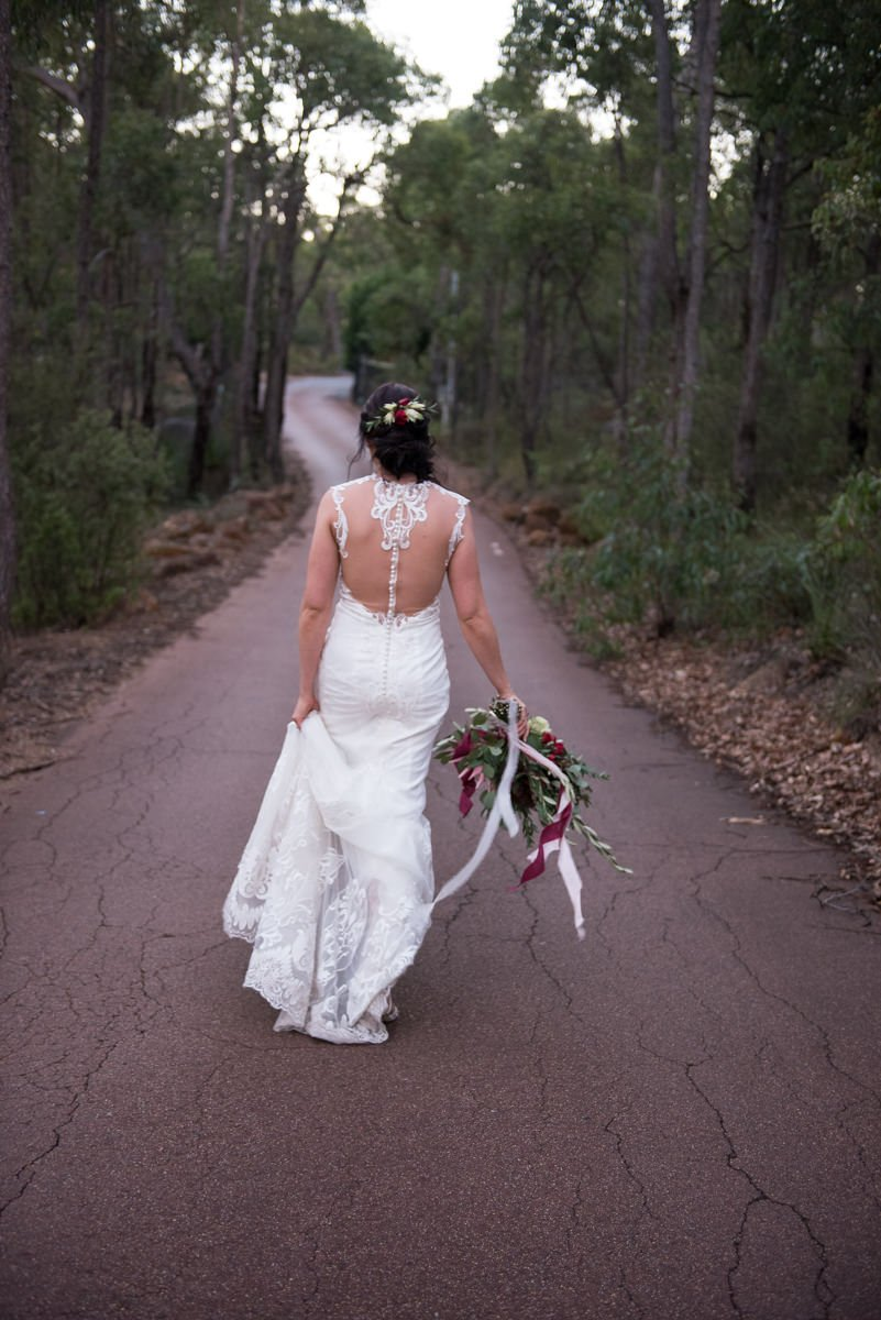 bride walking winding road