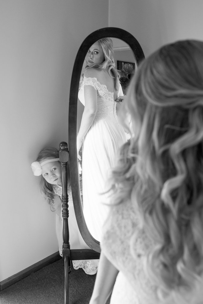 flower girl behind the mirror