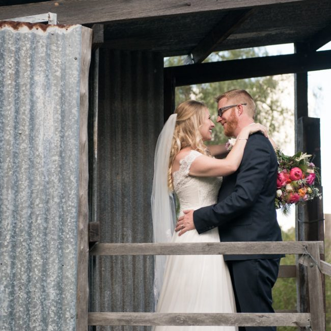 Bride and groom in an old shed
