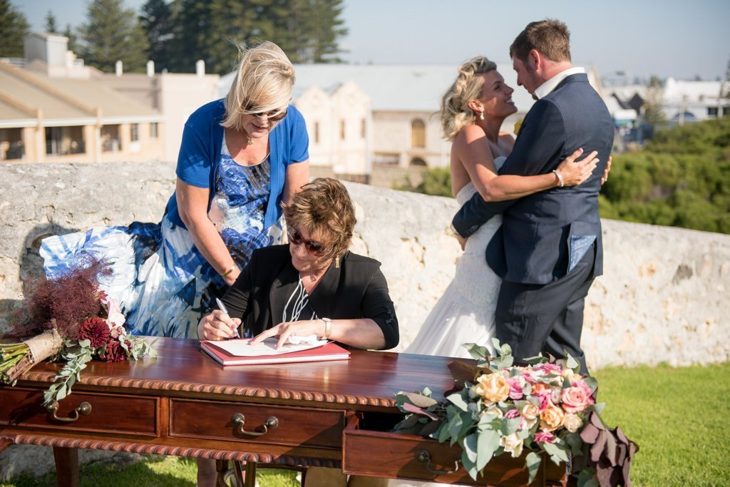 signing the wedding papers
