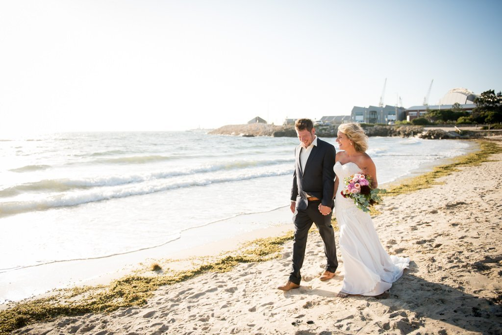 newlyweds walking along Bathers Beach