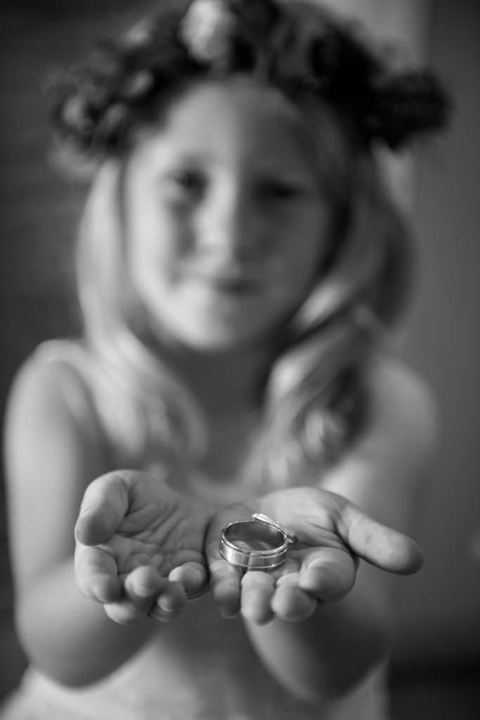 flowergirl holding wedding rings