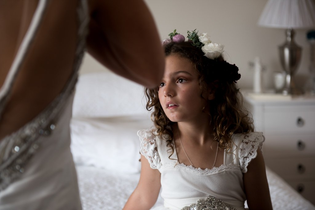 flower girl watching the bride getting ready