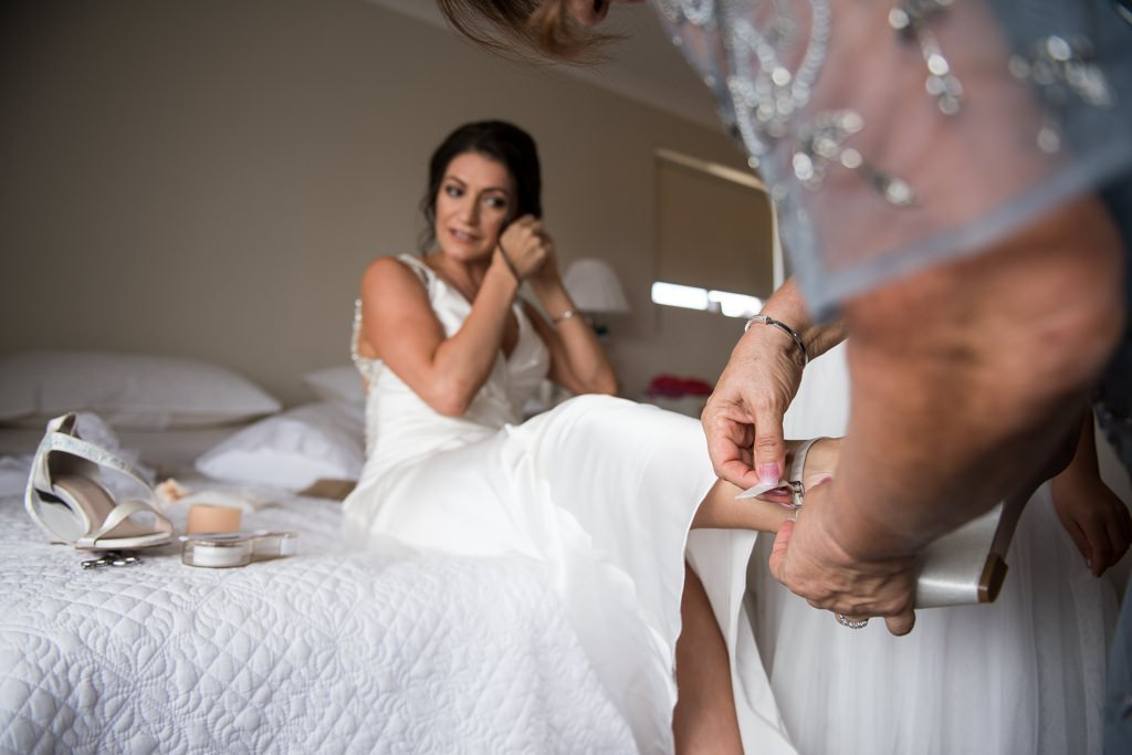 mother of the bride helping