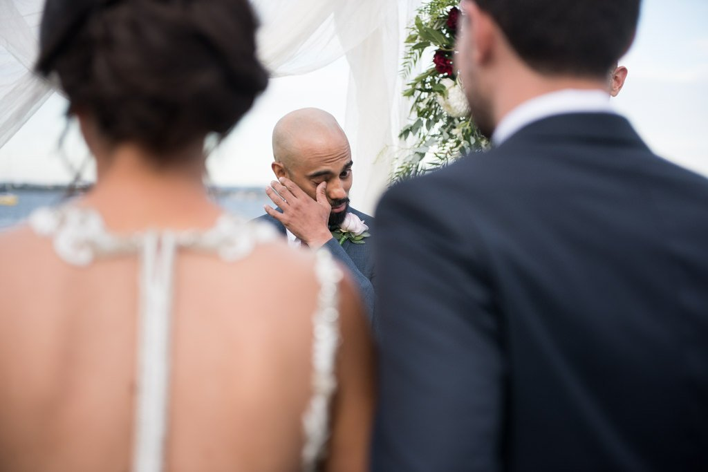groom wiping a tear