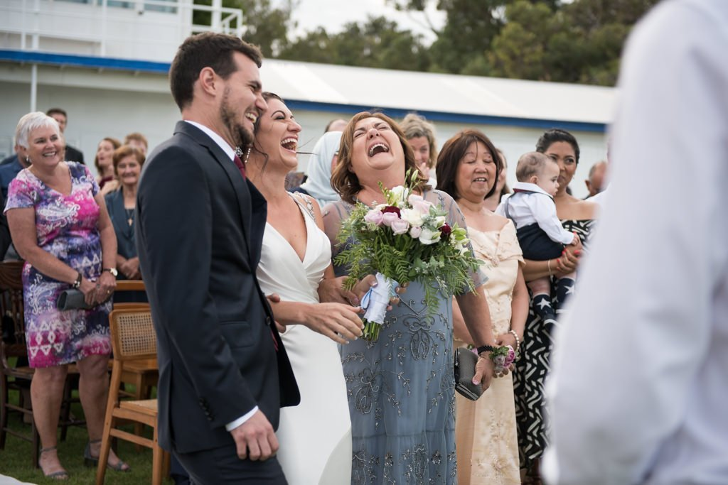 bride and mum and brother laughing