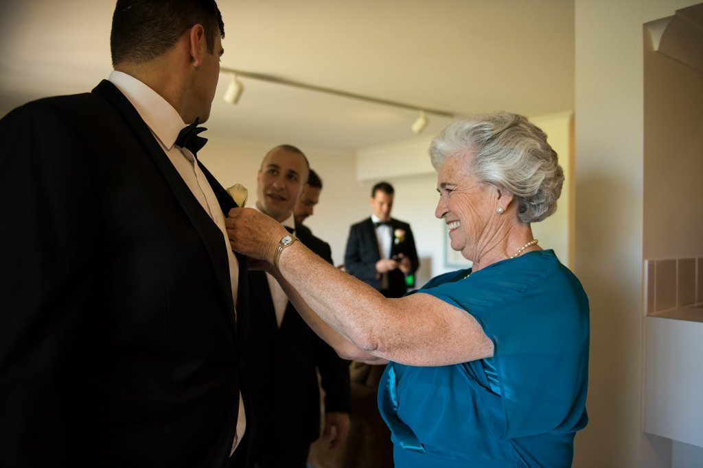 grandmother fixing the buttonhole