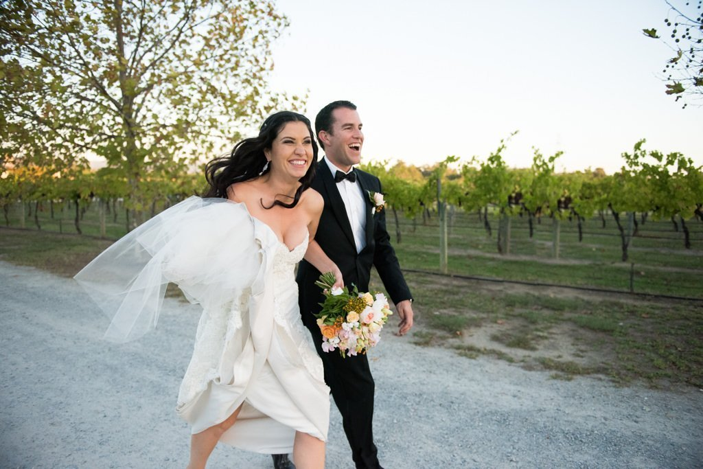 bride and groom walking in the swan valley wine region